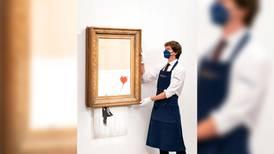Banksy vale millones aun hecho 'pedacitos': obra autodestruida se vende en 25 mdd